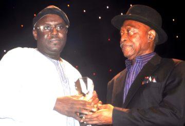 GMD, Royal Exchange Plc, Alhaji Auwalu Muktari receiving his award from Mr. Sam Amuka
