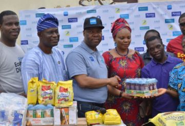 (L-R) Rotimi Morohunfola, Head Commercial Bank, Ecobank Nigeria; Ade Abatan, School Support Services, State Universal Basic Education Board (SUBEB); Patrick Akinwuntan, Managing Director, Ecobank Nigeria; Mrs. Sherefat Abike Rabiu, Head Teacher, Modupe Cole Memorial Child Care and Treatment Home and some students and Unwana ESANG, Ecobank Result Delivery Office during to visit of Ecobank Team to Modupe Cole Memorial Child Care and Treatment Home being part of activities to mark 2018 Ecobank Day in Lagos.