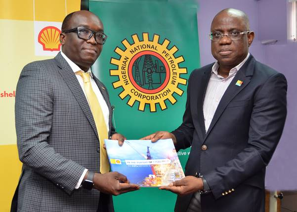 Managing Director, Shell Nigeria Exploration and Production Company (SNEPCo), Bayo Ojulari (right) presenting a copy of SNEPCo's In Pursuit of Excellence, to the Nigeria Council Chair, Society of Petroleum Engineer, Debo Fagbami, during a courtesy visit to the SNEPCo head office in Lagos state…. on Thursday. In Pursuit of Excellence is a publication detailing the pioneering feats of SNEPCo in Nigeria's deep water exploration.