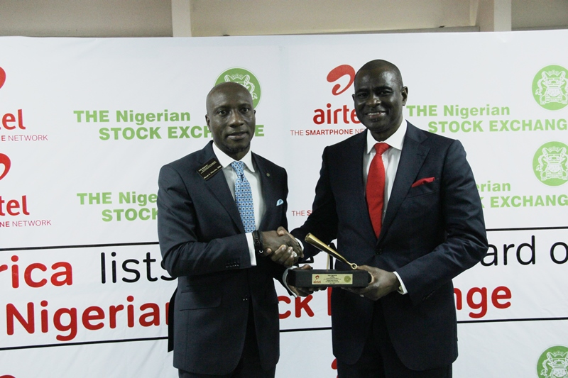 IMG_0543: Oscar Onyema, Chief Executive Officer, Nigeria Stock Exchange presenting  Segun Ogunsanya, CEO/ Managing Director, Airtel Nigeria 'The NSE Gong' Plaque during Airtel Africa Listing  at the NSE Headquarters in Lagos  on Tuesday, July 9, 2019.