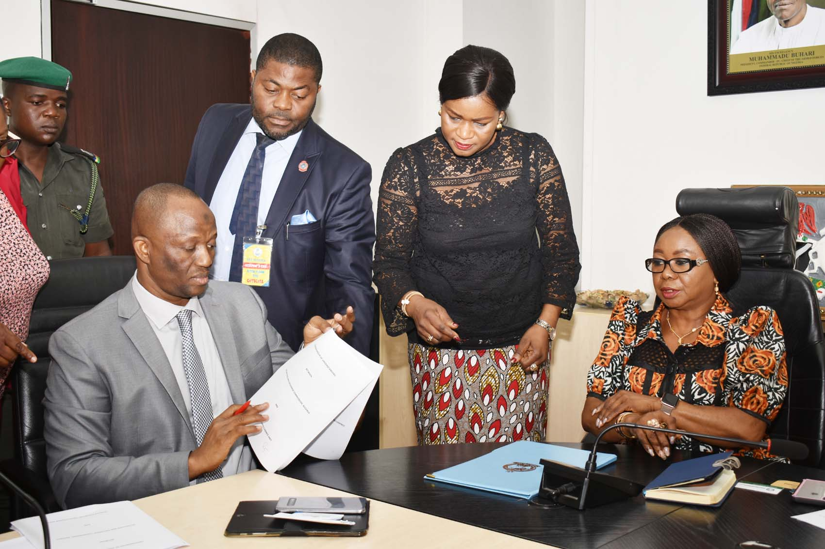L-R,  Director, Nigerian Financial Intelligence Unit, Mr Modibbo Tukur,  Head Public Affairs NFIU Mr Dominic Offor,  Head Legal, Securities and Exchange Commission Mrs Anastasia Braimoh and Acting, Director General,  SEC Ms Mary Uduk  during the Signing of MOU between SEC and NFIU in Abuja, Wednesday