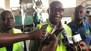 Engr. Obiora Manafa, SON Director, Compliance Monitoring, addressing the Press on the seized substandard aluminium roofing sheets in Uyo, Akwa Ibom State. He's flanked by Dauda Mshelia, SON State Coordinator, Akwa Ibom (left) and Benedict Preake, a Standards Enforcement Personnel