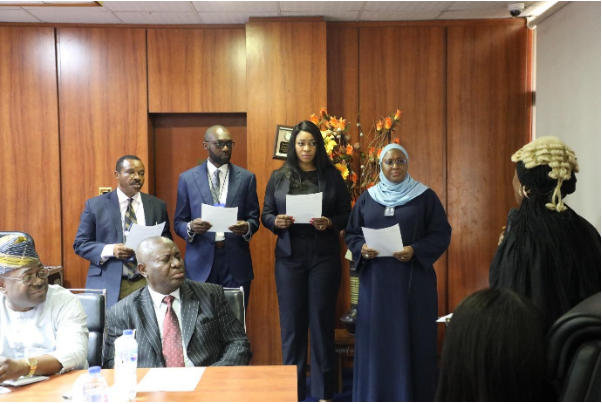 New members of the Nigeria Deposit Insurance Corporation (NDIC) Anti-Corruption and Transparency Unit (ACTU) taking the oath of membership conducted by the lawyer from the Independent Corrupt Practices Commission (ICPC) in the presence of NDIC Executive Director Corporate Services, Hon. Mrs. Omolola Abiola Edewor Director Internal Audit Department, Mr. Abiodun Longe and NDIC Board Secretary and Director Legal Department, Mr. Belema A. Taribo.