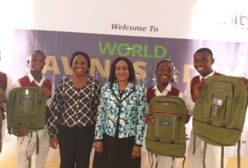 Caption: Chief Customer Service Officer, Unity Bank Plc, Mrs. Titilayo Abraham and Branch Manager, Stella Iheazue, Nkpor Branch, Unity Bank Plc flanked by Students of Dennis Memorial Grammar School, Onitsha, Anambra State during the World Savings Day Training.