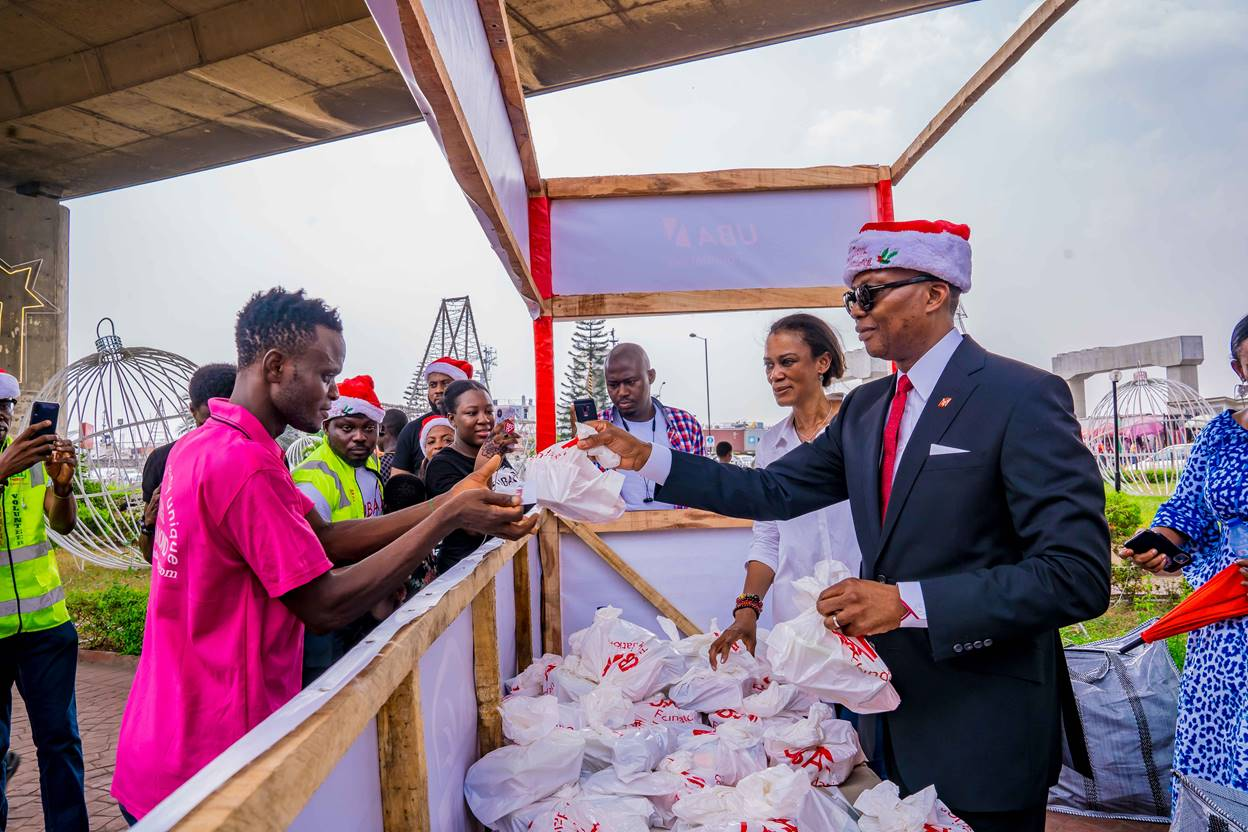 UBA's Group Managing Director/Chief Executive Officer, Mr. Kennedy Uzoka and CEO, UBA Foundation, Mrs. Bola Atta handing over food items and other goodies to the helpless and under-privileged at the Food Bank organised by UBA Foundation at the Foundation's Garden and Roundabout in Marina, Lagos on Friday
