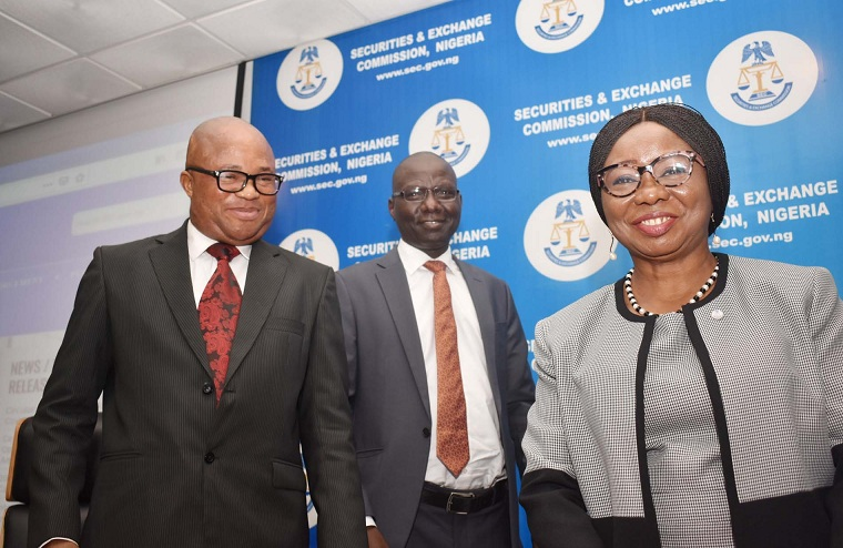 L-R, Head Anti-Corruption Unit, Independent Corrupt Practices and other Related Offences Commission Barr Ifeanyi Obialor, Acting, Executive Commissioner Operations, Securities and Exchange Commission Mr Isyaku Tilde and Acting Director General  SEC Ms Mary Uduk during the Inauguration Ceremony of Anti-Corruption, Transparency Unit and Monitoring Unit of SEC in Abuja yesterday