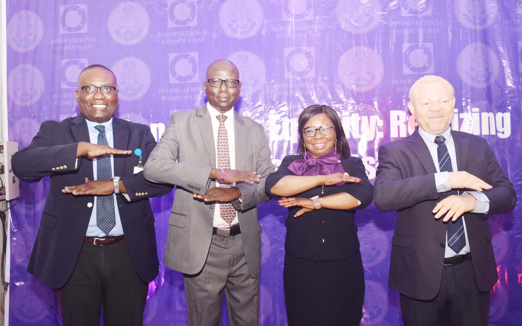 L-R, Acting Executive Commissioner Corporate Services, Securities and Exchange Commission Mr Edward Okolo , Acting Executive Commissioner,  Operations, SEC  Mr Isyaku Tilde, Acting Director General SEC  Ms Mary Uduk and Acting Executive Commissioner Legal and Enforcement  SEC, Mr Reginald Karawusa during 2020 International Women's  Day Celebration in Abuja, Monday