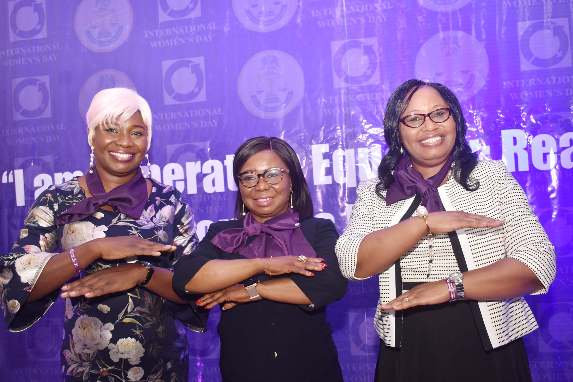 L-R, Obstetrician Gynaecologist Alliance Hospitals and Services Dr Becky Adeyemi, Acting Director General SEC  Ms Mary Uduk  and Leadership and Management Consultant Dr Karmell Andzenge during 2020 International Women's  Day Celebration in Abuja, Monday