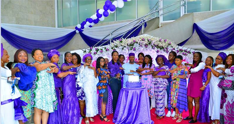 Managing Director, Ecobank Nigeria, Patrick Akinwuntan (middle), on his left, Executive Director, Commercial Banking, Carol Oyedeji and other female Ecobankers during the Bank's commemoration of this year's International Women's Day (IWD) at the Bank's head office