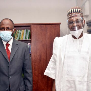 L-R, Director General, Securities and Exchange Commission Mr Lamido Yuguda with Minister of Communications and Digital Economy Mr Ali Pantami during a Meeting between SEC and Minister of > Communications and Digital Economy in Abuja yesterday