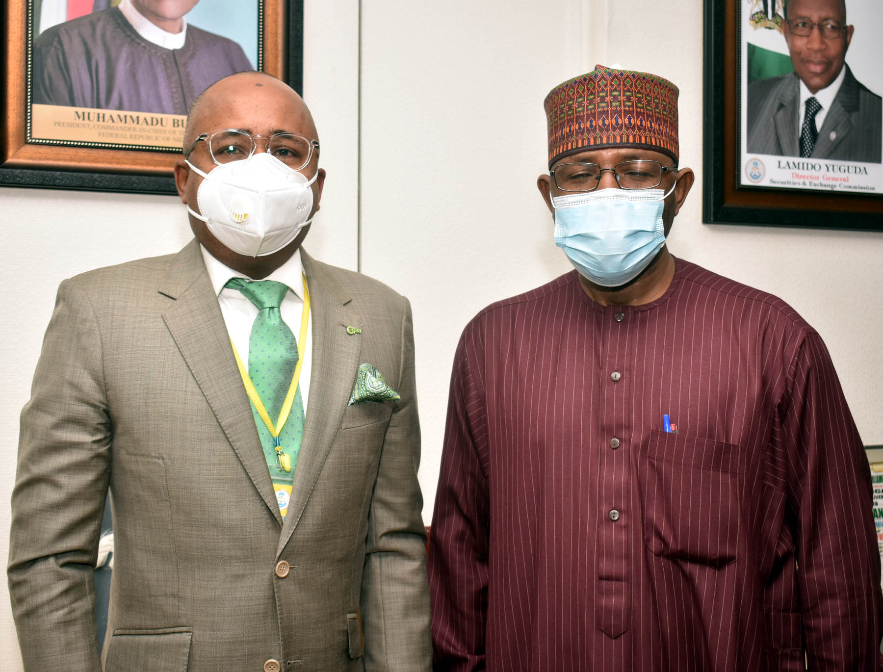 L-R,  Managing Director Central Securities Clearing >> System Plc Mr Haruna Jalo-Waziri with Director General Securities and >> Exchange Commission Mr Lamido Yuguda during a meeting between the SEC >> and CSCS in Abuja yesterday