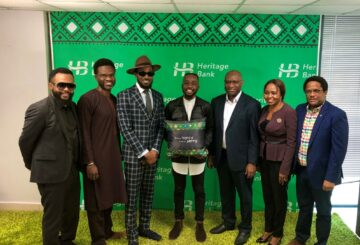 L-R: MD/CEO, Heritage Bank Plc, Ifie Sekibo (5th from Left); CEO, Cream Platform, Damian Okoroafor; Musician and Ynspyre Account's Ambassaor, Daniel Oyebanjo (D'banj); Winner of Ynspyre Account N1m online giveaway competition, Damilola Adeyemi; Group Head, Entertainment, Lagos Island 1 Zone, Kufretido Etim and Dike Dimiri, Regional Executive, Lagos & South-West, during the N1million cheque presentation to the winner of an online giveaway competition to celebrate the bank's Ynspyre Account ambassador, inspired by Heritage Bank yesterday at the bank's head office.